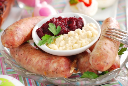 traditional polish white sausage with beetroot and horseradish sauce on easter table