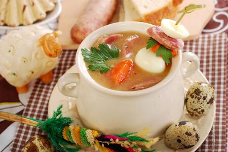 traditional easter white borscht with quail eggs and sausage on sick in rural style photo