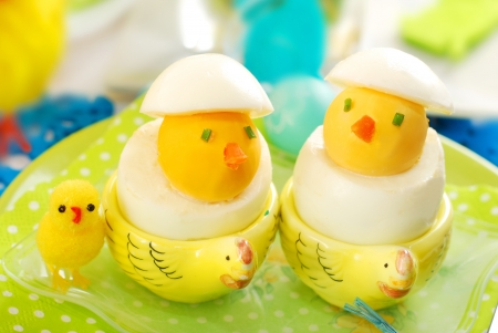 hard boiled: easter chickens made from hard boiled eggs as funny breakfast for child