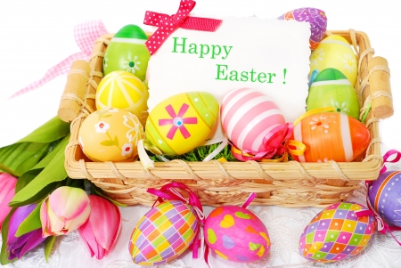 colorful decoration with easter painted eggs and greeting card in wicker basket Stock Photo - 18250231