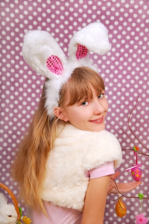 Easter bunny girl with funny ears on purple background with dots
