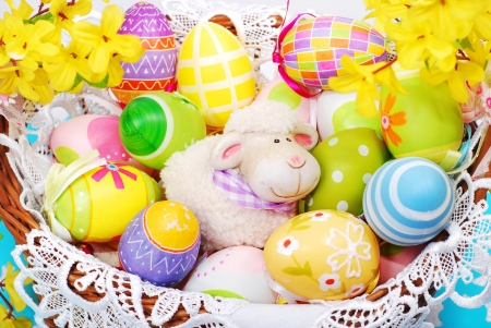colorful decoration with easter painted eggs and sheep figurine in wicker basket Stock Photo - 18289292