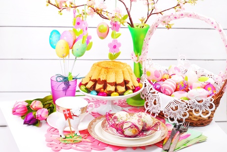 easter table decoration with marble ring cake and eggs in wicker basket Stock Photo - 18389129