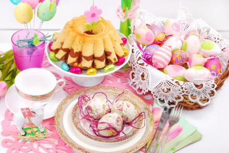 easter table decoration with marble ring cake and eggs in wicker basket Stock Photo - 18389126