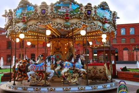 beautiful retro carousel with horses in the evening photo