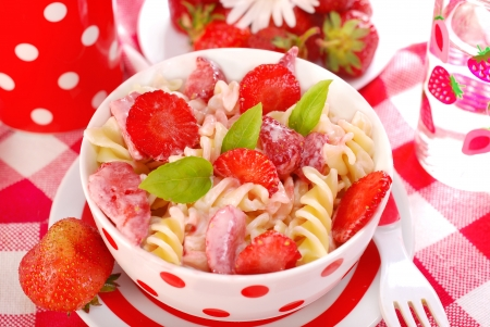 fusilli: fusilli pasta with strawberry and cream as lunch for child