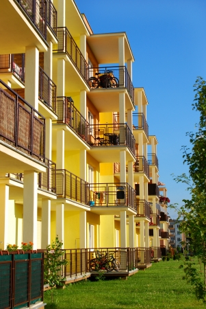 newly inhabited yellow block of flats and apartments