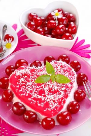 mascarpone: delicious heart shape cherry cake with mascarpone cheese and jelly Stock Photo