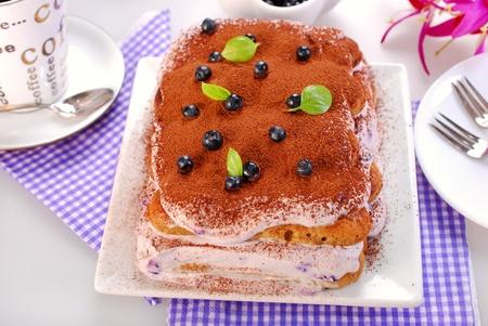 mascarpone: delicious blueberry tiramisu cake with fresh fruits and mascarpone cheese Stock Photo