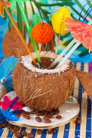 iced coffee served in coconut shell on tropical beach photo