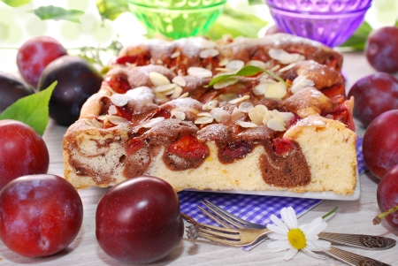 delicious  marble cake with plums  and almond flakes photo