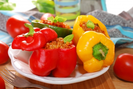 three color bell peppers baked and stuffed with minced meat and vegetables photo