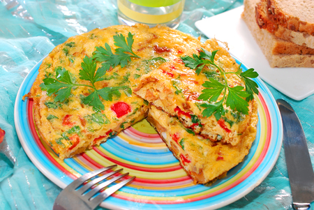 frittata with chanterelle,onion,red pepper and parsley for autumn breakfast or lunch photo