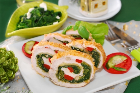 chicken roulade with spinach,cheese and red pepper for christmas dinner  Stockfoto