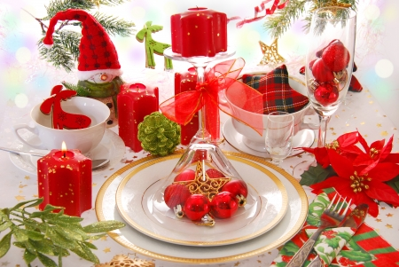 elegant christmas table decoration in red,green,white colors with candles  photo