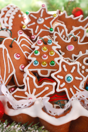 beautiful homemade gingerbread cookies in basket baked to hang them on christmas tree photo