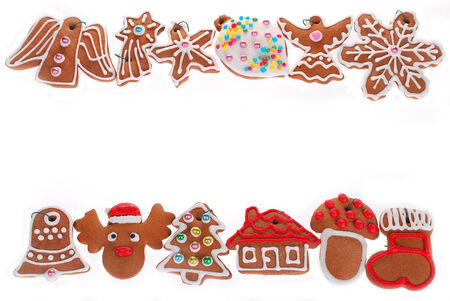christmas border with gingerbread cookies decorated with icing isolated on white photo