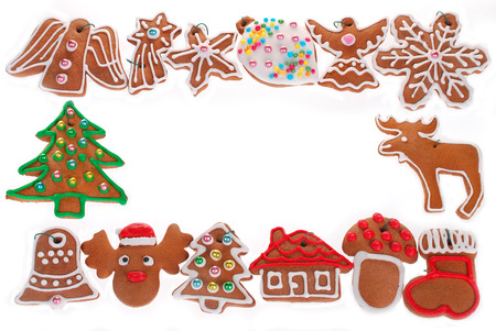 christmas frame with gingerbread cookies decorated with icing isolated on white photo
