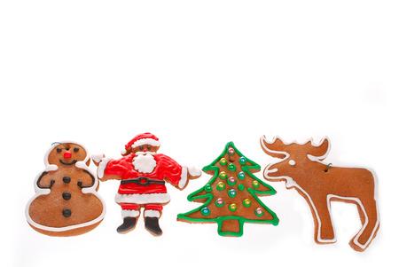 renos de navidad: frontera de Navidad con galletas de jengibre decorado con glaseado aislado en blanco Foto de archivo