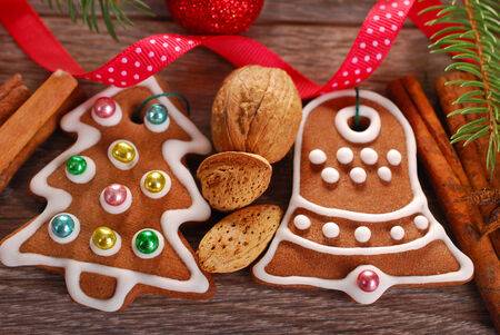 christmas decoration with gingerbread cookies,nuts and spices on wooden background Stock Photo - 24188296