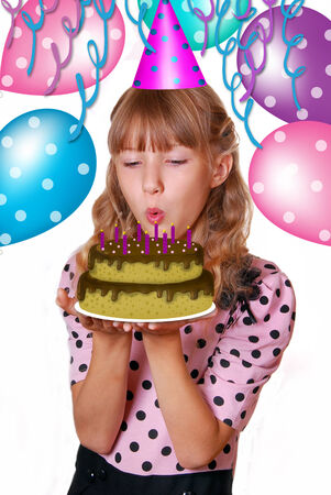 beautiful young girl blowing out candles on birthday cake isolated on white