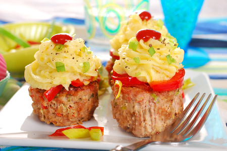 cupcakes made from baked minced meat,potato puree and vegetables for dinner photo
