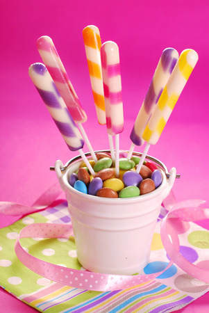kids birthday party: long striped lollipops on birthday party for kids at pink