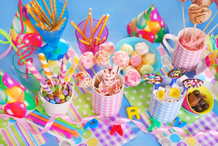 kids birthday party: colorful birthday party table with homemade sweets for kids   top view