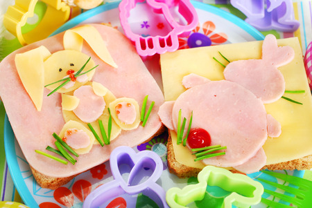 easter sandwiches with funny bunny made from ham,cheese and chives for kids Banco de Imagens