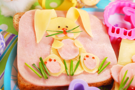 easter sandwich with funny bunny made from ham,cheese and chives for kids