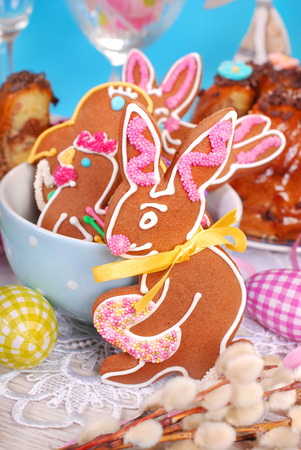 colorful homemade gingerbread cookies in bunny and hen shapes with sprinkles for easter photo