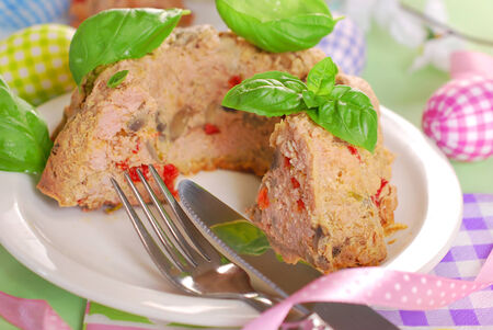 meatloaf: easter meatloaf in ring cake shape with mushrooms and red pepper for dinner  Stock Photo
