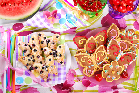 butterfly shaped gingerbread and puff pastry cookies with blueberry for children s birthday party photo