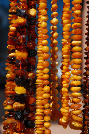 amber: beautiful polish amber necklaces hanging at exhibition Stock Photo