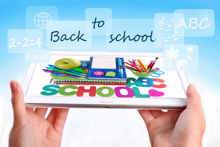 back to school concept with hands holding tablet pc displaying school staffs and text photo