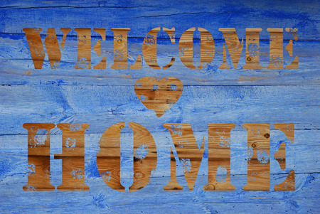 blue wooden background with written text -welcome  home photo
