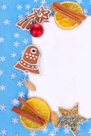 christmas frame with gingerbread cookies ,spices and decorations on blue background photo