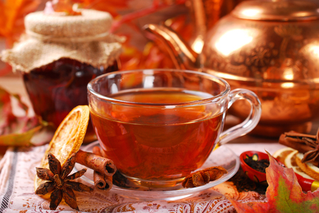 glass of autumn tea with orange ,spices and honey photo