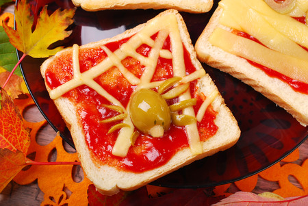 funny sandwich with cheese web and green olives spider for halloween party photo