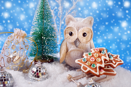 winter scene with owl figurine and christmas gingerbread cookies on sledge photo
