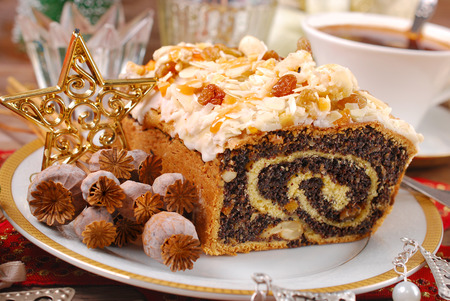 poppy seeds: rolled poppy seed cake with nuts and raisins for christmas