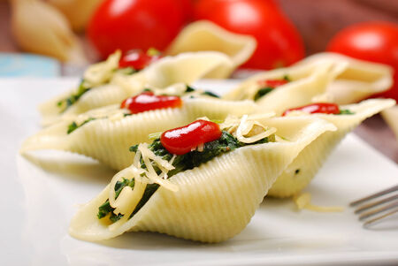 pasta shells stuffed with spinach ,eggs and cheese photo