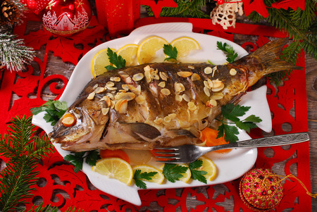 roasted whole carp stuffed with vegetables and almonds  for christmas-top view