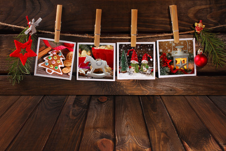 empty wooden floor and four christmas photos hanging on twine photo