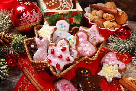 colorful christmas gingerbread cookies with icing and sprinkles made by kids photo
