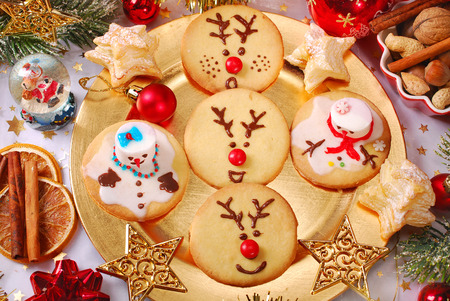funny snowman and reindeer shaped christmas cookies made by kids photo