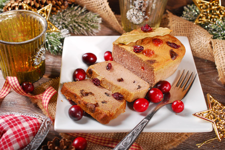 pate: homemade goose pate with cranberries on plate for christmas Stock Photo
