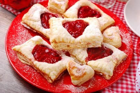puff pastry: puff pastry cookies with raspberry confiture in heart shape for valentine party