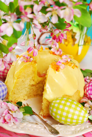 lemon ring cake with yellow icing sugar on easter table photo