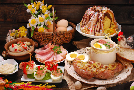 easter flowers: easter traditional polish dishes on rural wooden table Stock Photo